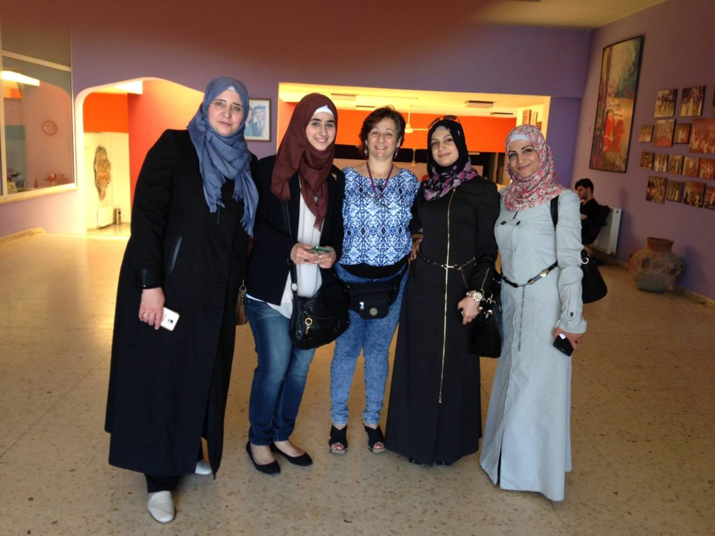 PHOTO ABOVE: Iman Aoun of Ashtar Theatre (c) with four of the women who gave their monologues, Jordan refugee camp in 2016